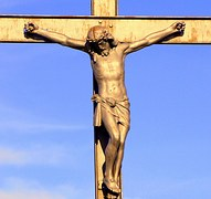 Picture of Jesus on a Cross with a blue sky background