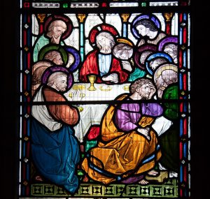Stained glass window of Jesus and the 12 Apostles
